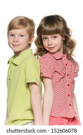 Fashion  redhead girl and boy are standing together on the white background