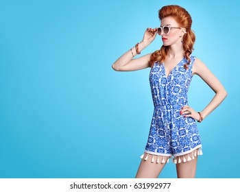 Fashion Redhead Model in Jumpsuit, woman in Trendy Summer Dress. Stylish wavy hairstyle, Sunglasses, Floral Outfit. Glamour Playful Beauty Girl, Luxury Lady