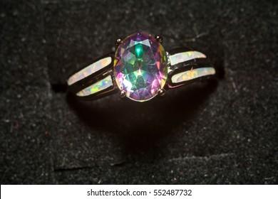 Fashion ring with mystic topaz, rainbow topaz, modern jewelry.