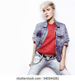 Fashion rock style. Denim clothing Glamorous Tomboy Blond hipster jeans Outfit