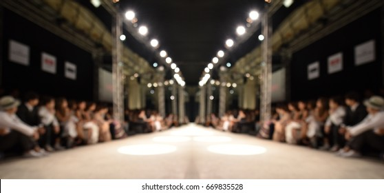 Fashion runway out of focus,blur background of empty runway full of first roll people
