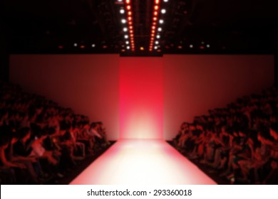 Fashion runway in red color lighting out of focus,blur background