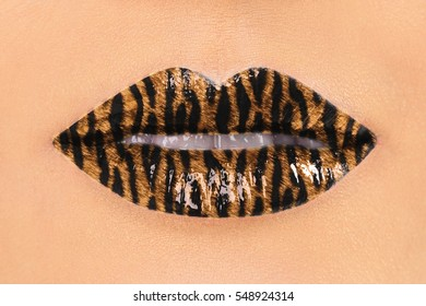 Fashion Sapphirine Sexy Lips with Tiger Pattern Closeup. Open Mouth. Make up concept. Kiss