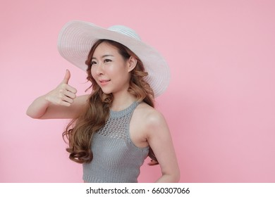 Fashion sexy girl in summer holiday, woman fashion in summer fashion with white hat on pink background