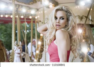 Fashion sexy model posing on carousel