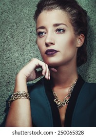 Fashion sexy woman model on green background portrait