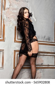 2074b77706d fashion sexy young woman in black lacy lingerie and stockings posing on old  wall