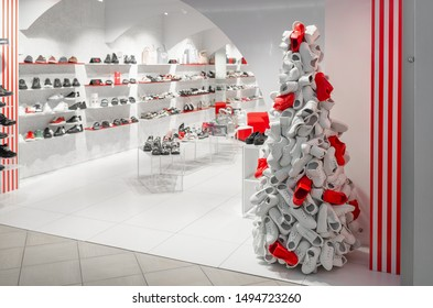 fashion shoe store in the mall. Christmas tree made of white and red sneakers