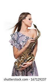 Fashion shoot of Beautiful blond girl posing with sax. Turning face in profile and standing isolated over white background