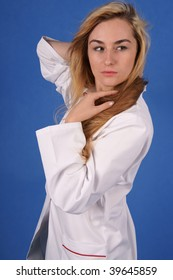 Fashion shoot of doctor in medical coat with hair blowing