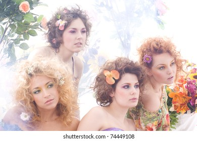 Fashion shoot of young beautiful nymphs in the spring forest
