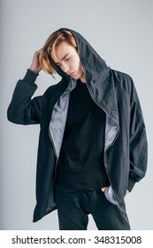 Fashion shoot. Young man in the jacket with hood