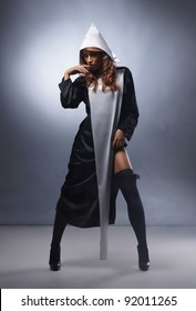 Fashion shoot of young sexy nun