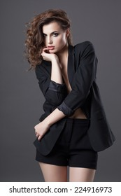 Fashion shoot of young woman in black jacket and shorts