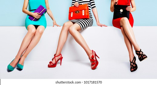 Fashion shopping image with colourful styles. 3 women sitting together on the bench.