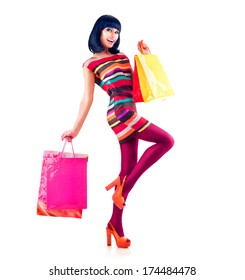 Fashion Shopping Model Girl full length Portrait. Beauty Woman with Shopping Bags isolated on White. Shopper. Sales