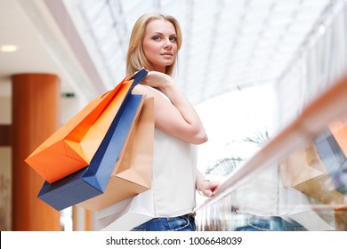 Fashion shopping woman walking with bags in shopping mall