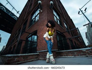 Fashion shot of beautiful afro american girl in vintage Brooklyn bridge park