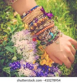 Fashion shot of a beautiful boho style girl on nature background. Boho, hippie.
