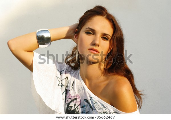 Fashion shot of beautiful model in white dress