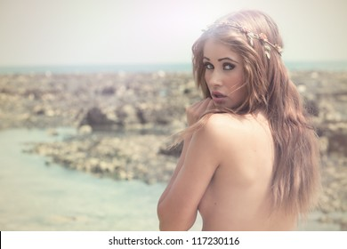 Fashion shot of beautiful young model at beach