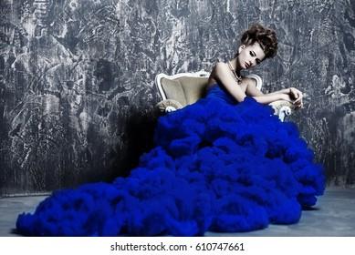 Fashion shot. Beautiful young woman wearing luxurious long dress and necklace. Luxury, rich lifestyle. Jewellery.