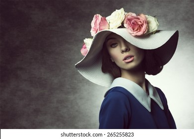 fashion shot of elegant girl with white hat and roses on it , vintage style , spring concept