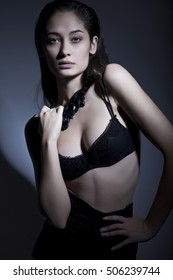 Fashion shot of a gorgeous young woman wearing necklace and bra beauty model