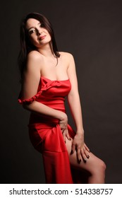 Fashion shot of a gorgeous young woman in elegant red dress