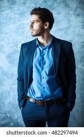 Fashion shot of a handsome man wearing elegant suit. Men's beauty, fashion. Businessman.