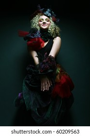 Fashion shot of lady in doll style. Creative make-up.Fantasy dress.
