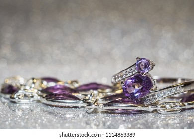 Fashion silver ring decorated with natural amethyst gemstone.