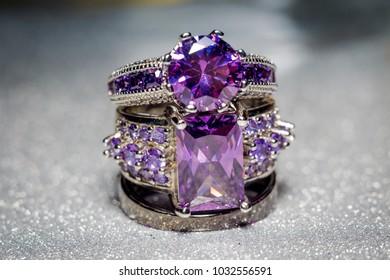 Fashion silver ring with purple zirconia, amethyst imitation.
