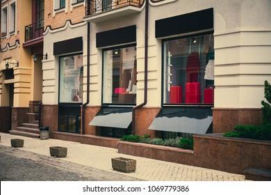 Fashion storefront, modern store signboard mockup.