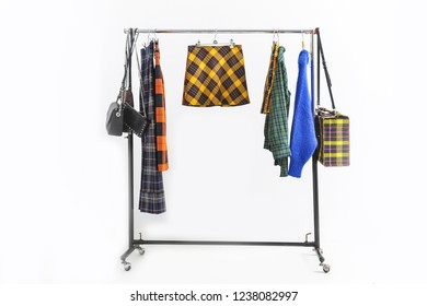 fashion stripy clothing with sundress ,skirt ,shirts ,handbag on hanging rack