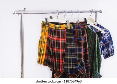 fashion stripy clothing with sundress,skirt ,sundress on hanging rack