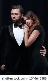 fashion studio photo of beautiful couple in elegant clothes