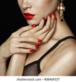 Fashion studio photo of beautiful lady with red lips and nails