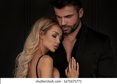 Fashion studio photo of beautiful sensual couple posing together.Love. Handsome young lovers.