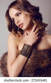 fashion studio photo of beautiful sensual woman with dark hair