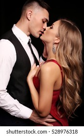 fashion studio photo of beautiful sexy couple. gorgeous woman with blond hair posing with handsome man, wearing elegant clothes