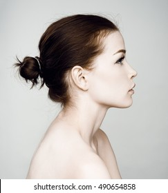 Fashion studio photo of elegant lady half-face