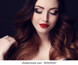 fashion studio photo of gorgeous sexy woman with dark hair and bright makeup