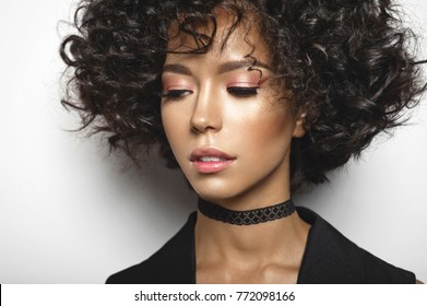 Fashion studio portrait of beautiful woman with afro curls hairstyle. Fashion and style. Beauty and health