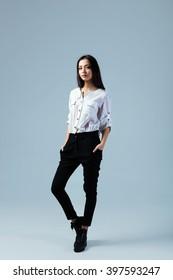 Fashion studio portrait of young elegant woman