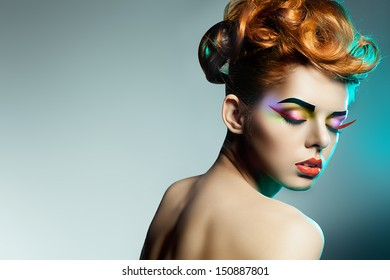 Fashion studio shot of beautiful woman with  Professional makeup and hairstyle