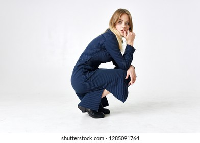 fashion style woman crouched