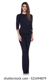 Fashion style woman perfect body shape brunette hair wear black suit jacket pants blouse elegance casual beautiful model secretary hostess diplomatic protocol office uniform stewardess business lady.