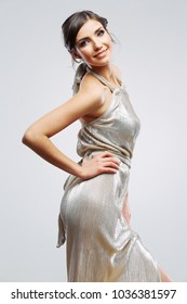 Fashion style woman wearing evening dress Studio isolated portrait, gray background .