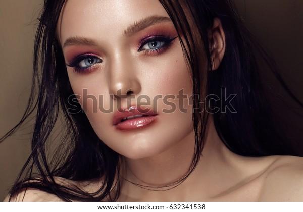 Fashion Stylish Beauty Portrait. Beautiful Girl's Face Close-up. Hairstyle. Professional Makeup.